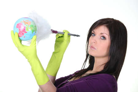 housewife gloves: Woman dusting a globe