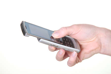 telco: female white hand handling mobile phone Stock Photo