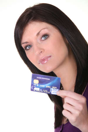 straight faced: Woman with a debit card