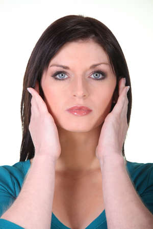 pounding head: Woman covering ears Stock Photo