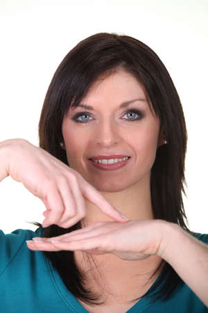 dictatorial: Donna che punta a mano