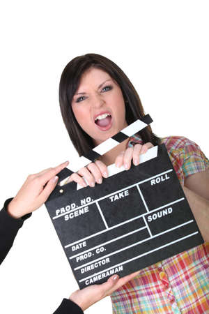 dissension: a woman having a hand caught in a movie clap