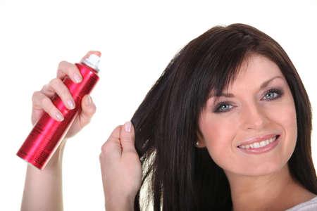 hairspray: Woman using hairspray
