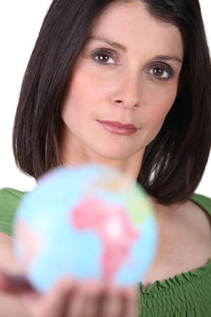 Woman holding a globe photo
