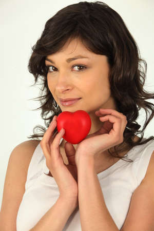 young woman holding a plastic hearth in her hand Stock Photo - 16191582