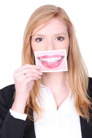 big teeth: woman holding a big picture of her mouth