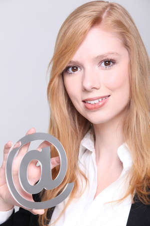 Redhead girl with at sign Stock Photo - 16191583