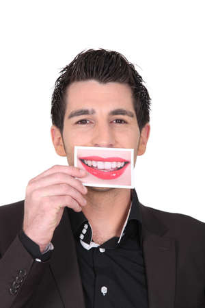 big mouth: Man holding photograph of lips
