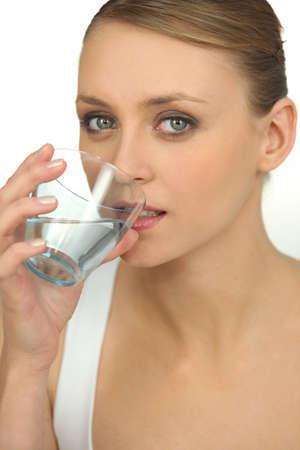 gulp: Blond drinking glass of water