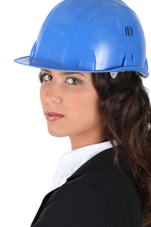 Woman wraing suit and hardhat photo