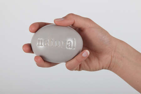 Hand holding soap marked  photo