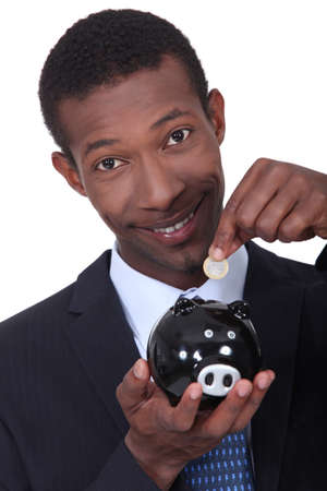 thrifty: portrait of a man with money box Stock Photo