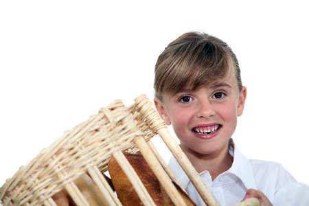 make belief: Young girl holding a bread basket
