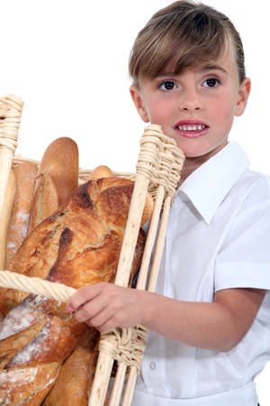 Little girl with basket of bread photo