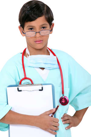 8 10 years: Young boy dressed as a doctor