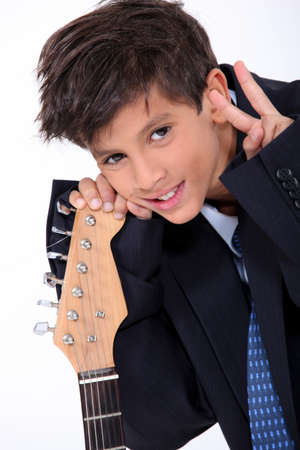 cool kids: Boy posing with his electric guitar