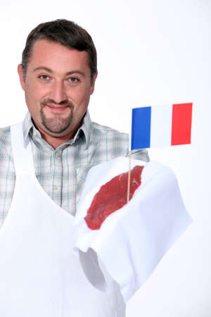 congenial: Butcher holding French beef