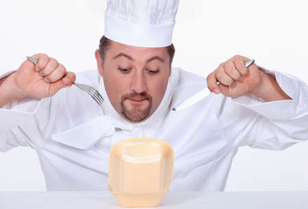 irony: Chef eating junk food Stock Photo