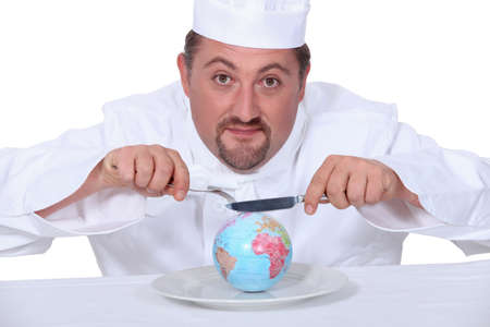 a puffy cook is eating a little globe photo