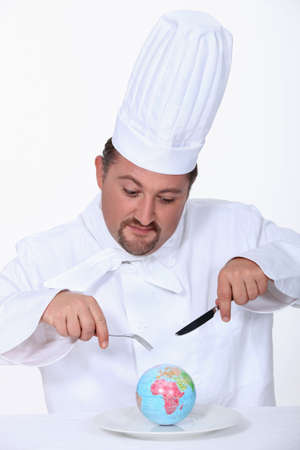 devour: Chef about to devour the world Stock Photo