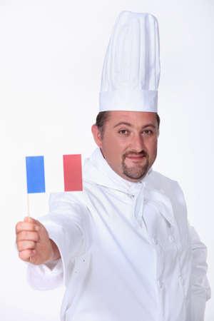man 40 50: Chef waving a French flag