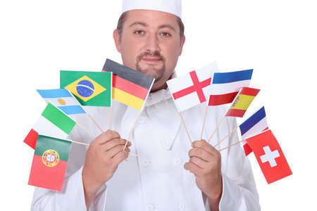national cultures: chef holding flags Stock Photo