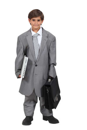 pretending: Boy dressed as a businessman Stock Photo