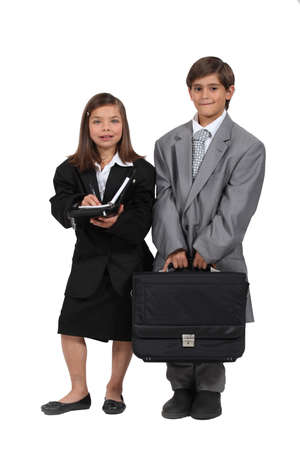 children wearing too large business clothes photo