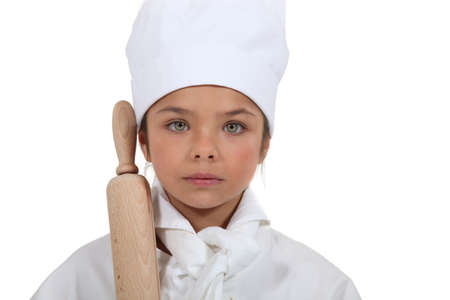 poker faced: Portrait of a young chef Stock Photo
