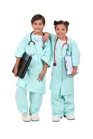 Two children dressed as doctors photo