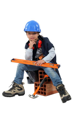 box construction: Child dressed as a builder