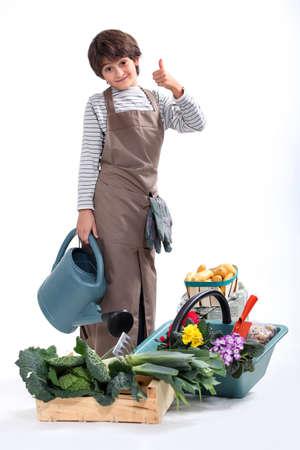 un niño vestido de jardinero Foto de archivo - 16191115