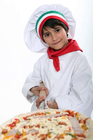 pizza maker: A young pizza maker