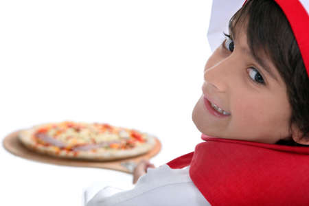 Young boy making pizza photo