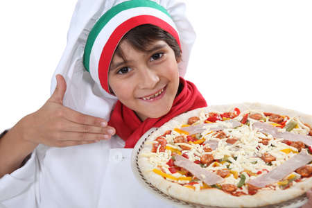 Young boy dressed as a pizza chef photo