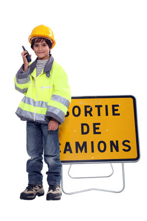 Young boy pretending to be a traffic guard photo