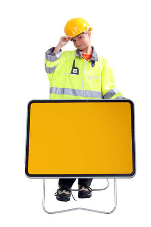roadworks: little boy in a costume of roadworks employee behind a traffic sign