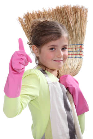 Little girl with broom photo