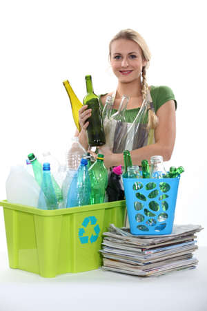waste prevention: Blond woman recycling Stock Photo