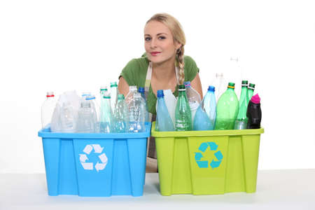 recycled water: Young woman with boxes for plastic recycling