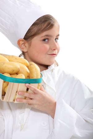 make belief: Girl with a crate of potatoes