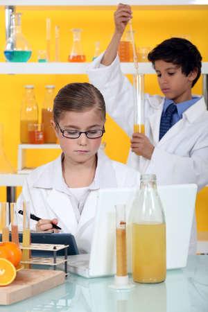 make belief: Children conducting an experiment