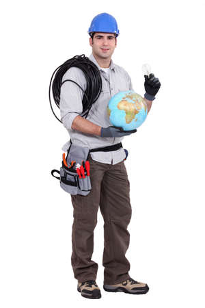 Electrician  holding a globe and a light-bulb photo