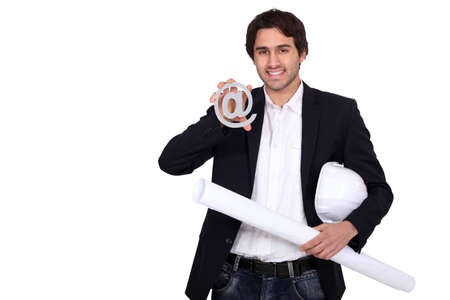 advisement: businessman holding a blueprint and an at sign Stock Photo
