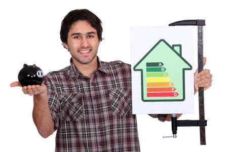 Man holding piggy-bank and energy efficiency logo photo