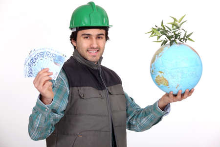 developing country: Tradesman holding a globe and a wad of money