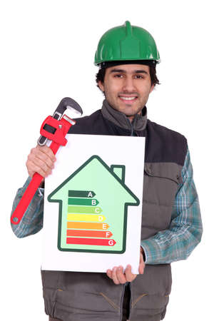 Plumber holding wrench and energy rating sign photo