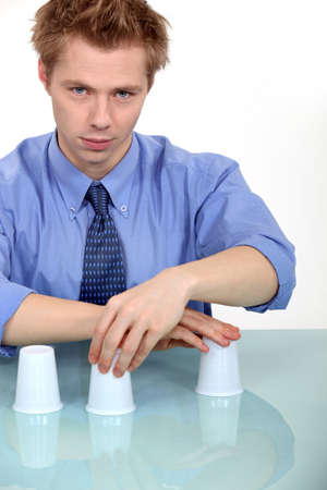 Man performing trick with three cups Stock Photo - 16191507