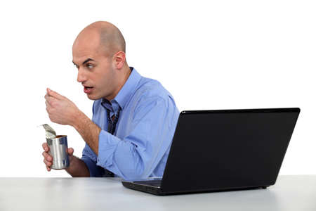 tinned: businessman eating from tin