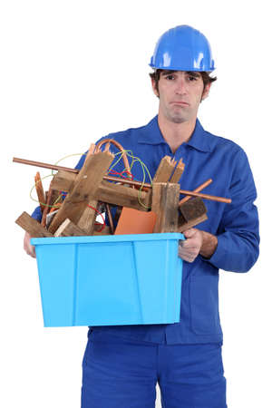hazardous waste: Construction worker recycling old wood
